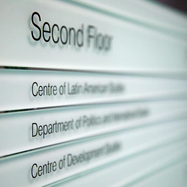 Second floor sign in Alison Richard Building showing Centre of Development Studies